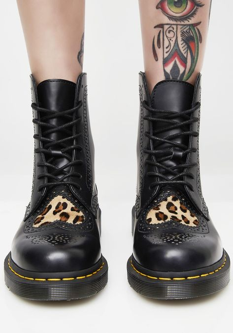 acac1e1155cd These black boots have leopard print panels on the front, dotted patterns  on the toes N' sides, and lace-up front closures. #dollskill #DrMartens ...
