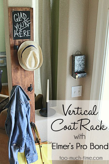 DIY entryway coat rack with a chalkboard, hooks, and knobs. Personalize your home with this tutorial via @kimtoomuchtime. #homedecor #homeorganization