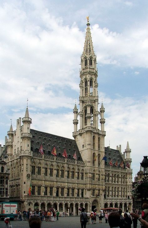 The Brussels Town Hall stands 96 metres ft) tall and is capped by a 3 metre ft) statue of Saint Michael slaying a demon, Brussels, Belgium.