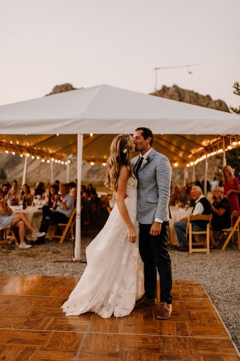 Quick kiss on the dance floor after the bride and groom's first dance. | Photo by Maggie Grace Photography #wedding #intimatewedding #microwedding #mountainwedding #lakesidewedding #bohowedding #bohoweddingdecor #fallwedding #weddingcolors #bohobride #bridalfashion #weddingdress #laceweddingdress #firstdance #reception #weddingreception #outdoorwedding #outdoorweddingreception #goldenhour