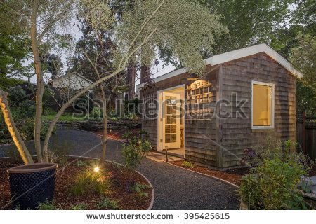 Attractive Timbered Garden Shed / Guest House At Twilight With Walkway.   Stock Photo