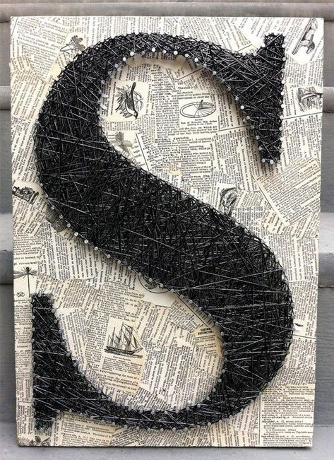 DIY Thread and Nails String Art - a treble clef on sheet music background?