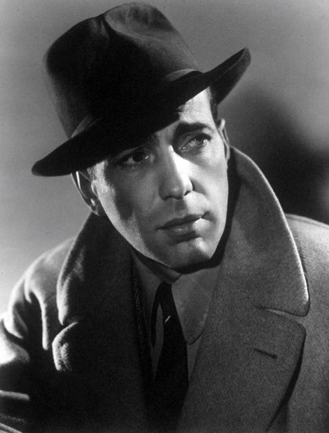 All men of mystery wear their collars up. Before Cumberbatch and the Belstaff coat, there was Bogart in his camel coat. Casablanca (1942).