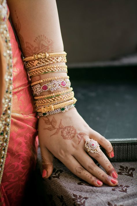 Gold bangles fifth from top