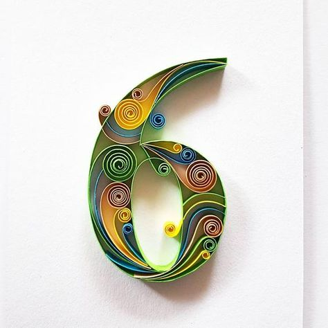 Handmade Quilling Paper Art with number 6  The art is made with 7mm paper strips.  Dimensions of the picture: 180x130mm.  Its placed in a white frame with dimensions 230x180mm.  The price includes the frame. The frame does not contain glass.  Please let me know through ETSY Conversation if you have