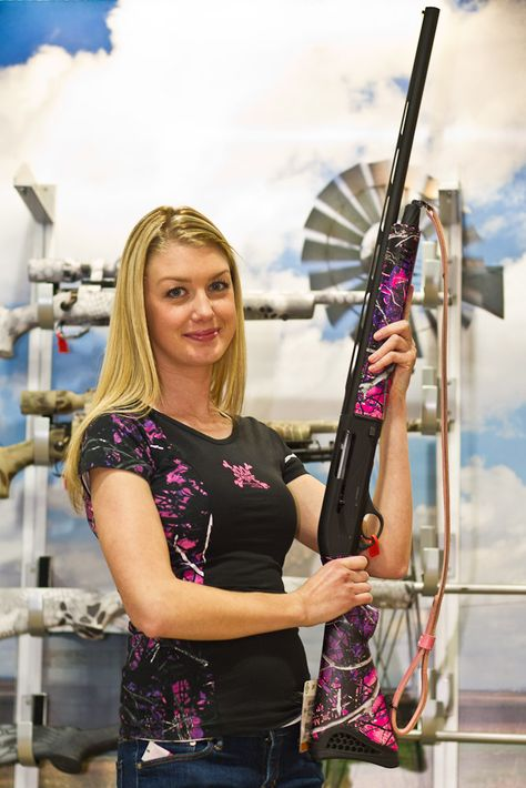 Legacy Sports International  The ladies at Legacy Sports International were showing off the new Moon Shine Attitude attire and Moon Shine camo patterns.    This Escort shotgun features the attractive new Muddy Girl pink camo pattern.        WANT THIS GUN,!