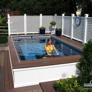 Pool Privacy Fence backyard deck endless pool® - this partially inground endless pool