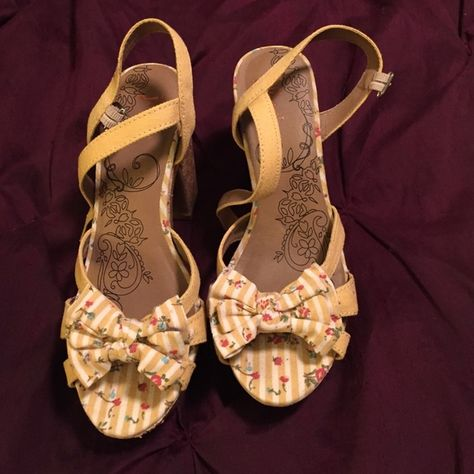 Jellypop yellow wedge heels Super cute yellow and cork shoes with stripe and floral pattern. Wore once and fell, hence  the scuff on the front of the right heel. Other than that they are in perfect condition. Jellypop Shoes Wedges