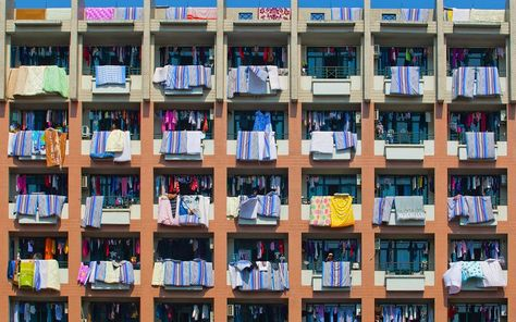 Ningbo, China - Students air out their duvet and bed sheets.