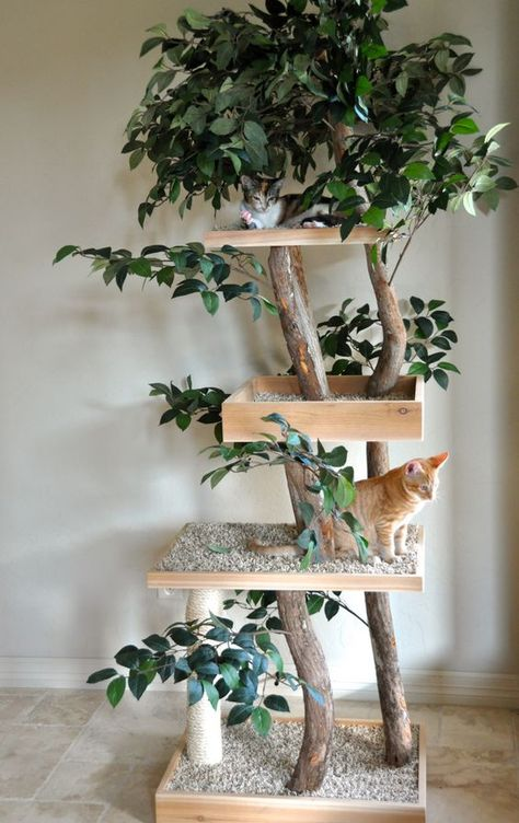 a nature inspired cat tree of branches, fake greenery and platforms with pebbles to make the cats feel like outdoors