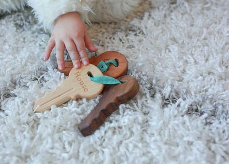 Let baby play with wooden keys - Awesome Wooden Toys For Kids - Photos