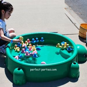 Carnival games ideas.. duck pond *check* .. we'd be able to toss books into baskets?? I like the penny drop game as well, it's pretty tricky!