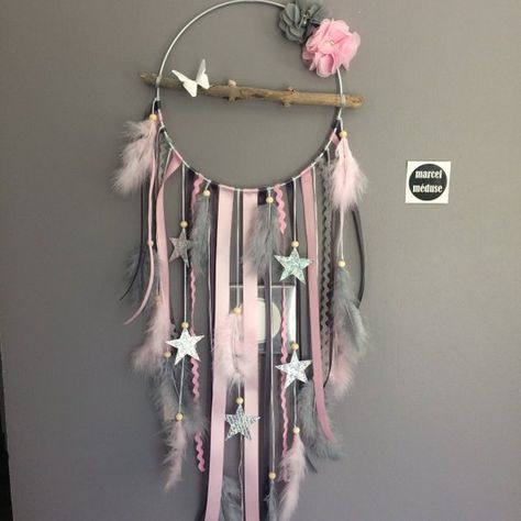 A beautiful Dreamcatcher made entirely by hand from natural Driftwood from Lake Geneva and natural feathers. Finely worked and embellished with various feathers, ribbons, accessories, wooden beads and ceramic. It also has origami butterflies resting on driftwood. Painted metal aluminum circle. A