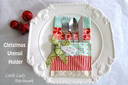 These cute Christmas utensil holders are one of the many free Christmas quilt table decorations you'll find in this collection.