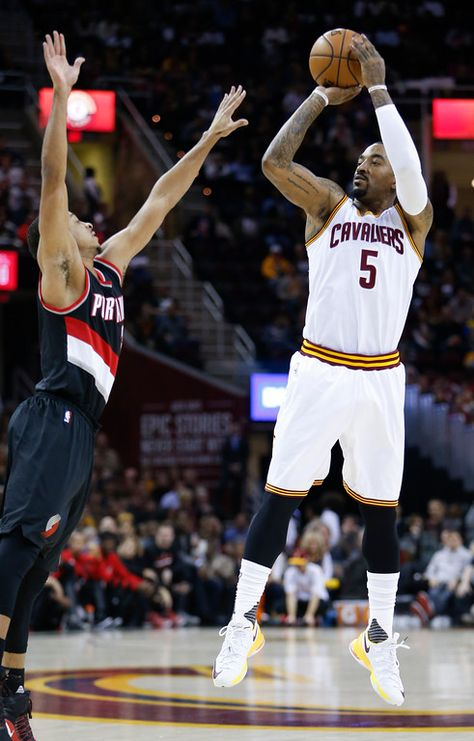 . Cleveland Cavaliers\' J.R. Smith (5) shoots over Portland Trail