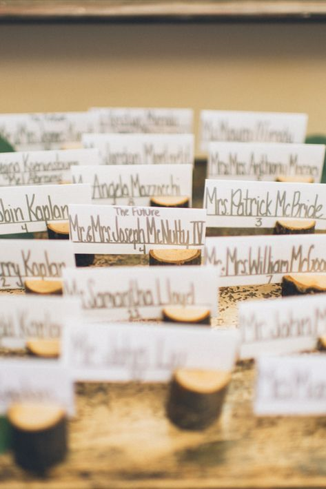 Mini wooden log place card holders for a wedding at Rock Island Lake Club in NJ | Photo: Pearl Paper Studio
