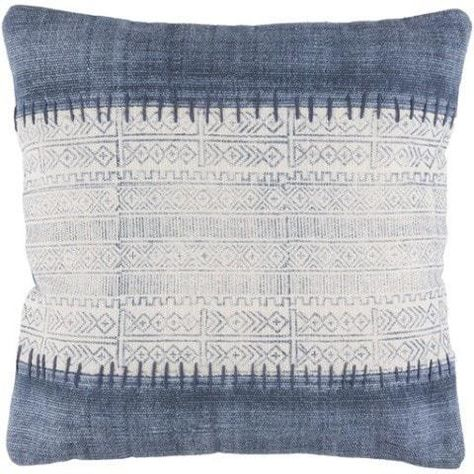 A large scale ikat style striped pillow