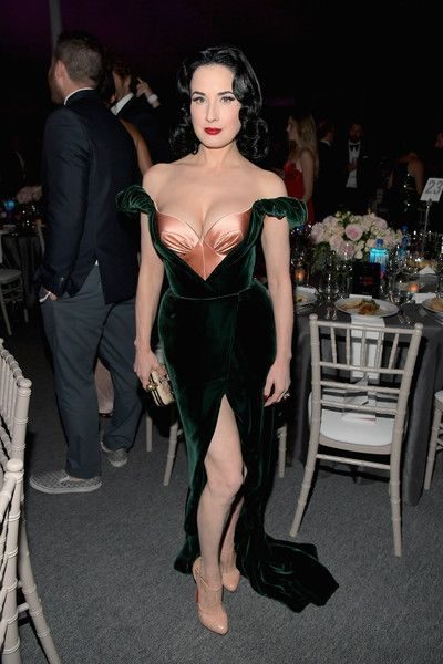 She is standing so weird ---Dita Von Teese Photos - Model Dita Von Teese attends the amfAR Gala Los Angeles 2017 at Ron Burkle's Green Acres Estate on October 2017 in Beverly Hills, California.