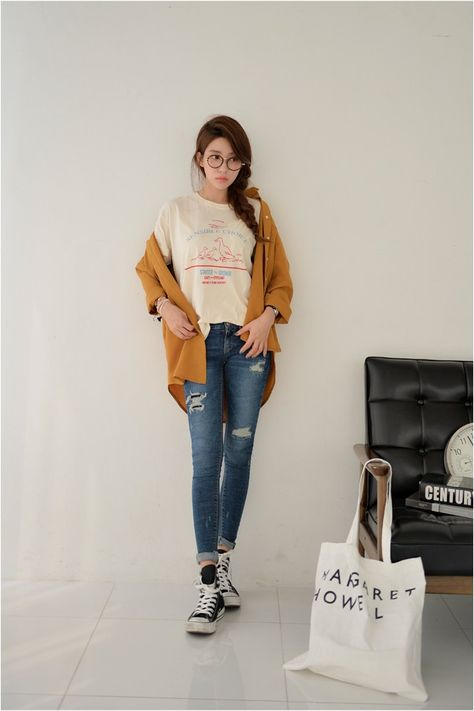 Korean fashion - beigie print tee, jeans, mustard yellow cardigan and black converses