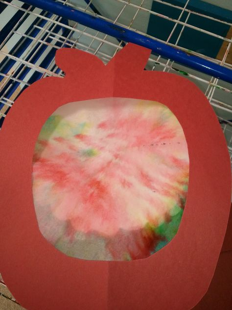 Use markers on coffee filter. Spray with water to make the colors bleed. Glue to the back of an apple that has the center cut out for a colorful apple craft. (via Fishers Pointe Cooperative Preschool)