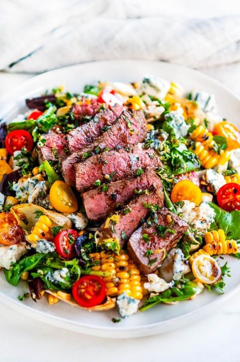 A 20 minute delicious steak and salad dinner recipe with tomatoes red onion home grilled corn gorgonzola cheese crumbles gremolata and balsamic vinaigrette. Perfect for the summer grilling months Salad Recipes For Dinner, Dinner Salads, Healthy Summer Dinner Recipes, Grilled Dinner Ideas, Dinner Menu, Dinner Ideas With Steak, Good Salad Recipes, Health Salad Recipes, Best Dinner Recipes Ever