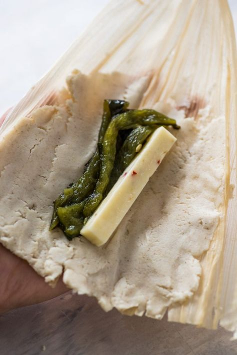 A Mexican classic, these Green Chile and Cheese Vegetarian Tamales are filled with roasted poblano peppers and spicy pepper jack cheese. Also gluten free! Authentic Mexican Recipes, Mexican Food Recipes, Ethnic Recipes, Mexican Desserts, Drink Recipes, Dinner Recipes, Filipino Desserts, Vegetarian Tamales, Vegetarian Recipes