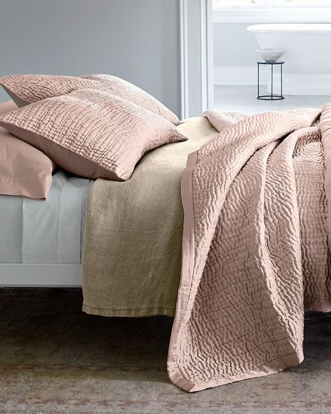Luminous sand-washed silk is quilted into hand-stitched waves of texture, creating a three-dimensional work of art. Backed with smooth cotton sateen. Quilt has extra-wide silk binding with mitered corners. #eileenfisher