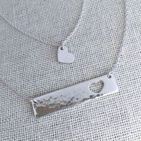 A daughter is a piece of your heart! This sterling silver necklace set includes a bar necklace and a heart charm necklace. If you have more than one daughter, y