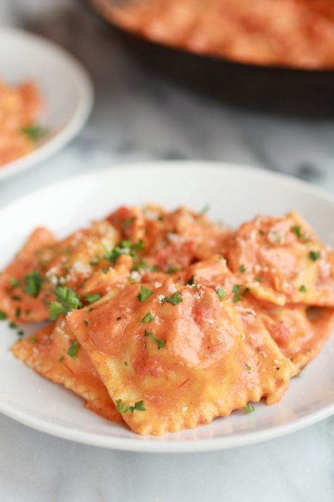 brown butter lobster ravioli with tomato cream sauce