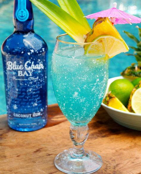 Pour ingredients into a glass filled with ice. Garnish with pineapple, lime, and an umbrella.  #bluechairbay #coconutrum #rum #coconut #coconutcocktail #easycocktail #easy #threeingredients #summercocktail #blue #bluedrink #pineapple #sodawater #happyhour #pool #summer #easydrink #drinkrecipe #recipe #rumon #poolcocktail #bluecocktail #bcbhappyhour #bcb