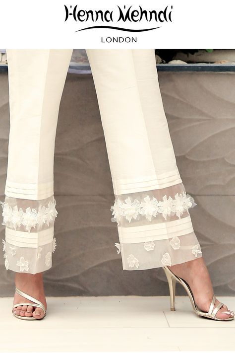 Designer Indian & Pakistani White Embellished Trousers available in Salwar Trousers, Embroidered Trousers and Bootcut trousers. Designed in London UK. Free delivery over £75. White embellished trousers with 3D flowers and pearl embellishment. Available in trousers, cigarette trousers or boot cut trousers. These can be ordered in black or white. Please note delivery time is approximately 4-6 weeks. There is no exchange or refund̴Ì_on this product as this item will be customised especia...