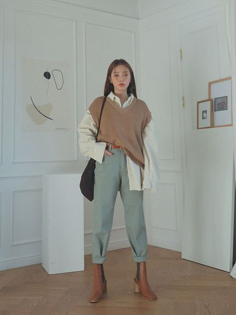 Outfits que te convencerán de usar chalecos oversized