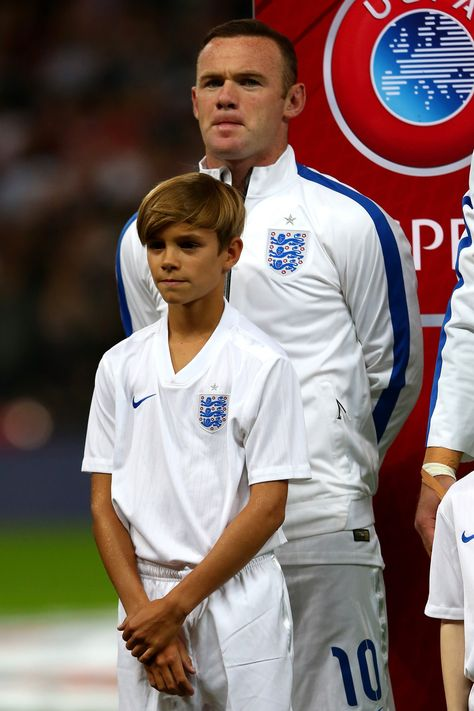 England captain Wayne Rooney and mascot Romeo Beckham line up for the national anthems prior to kickoff during the UEFA EURO 2016 Qualifier Group E match between England and Switzerland at Wembley Stadium on September 2015 in London, United Kingdom.