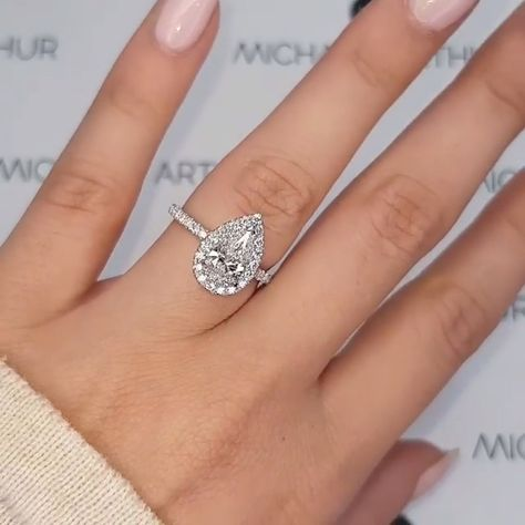 This stunning design featuring a pear cut diamond with delicate halo is one of our favourites