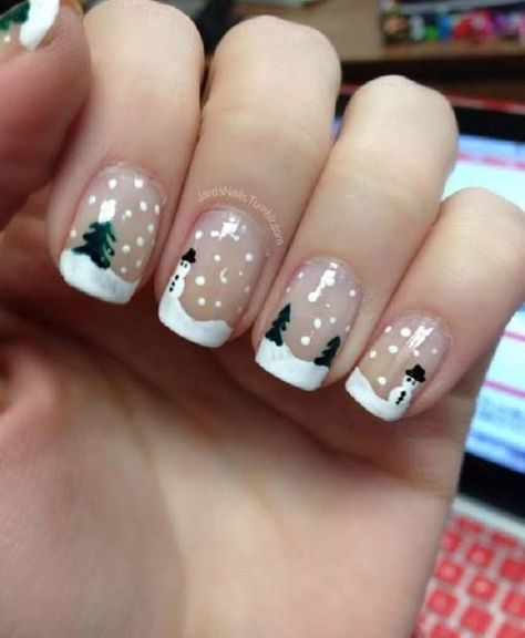 Paint wonderful snow landscapes on your nails with this Christmas nail art design. Use clear coat as your base and add Christmas trees in the background, falling snow and of course, don't forget to add an adorable snowman.