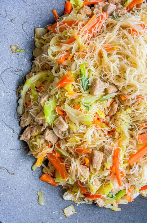 Pancit is a classic Filipino Recipe. It's a quick and easy stir-fried rice noodle dish with a savory sauce, pork and vegetables.