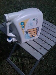 Reuse laundry detergent dispenser bottle to hold water for washing hands while camping