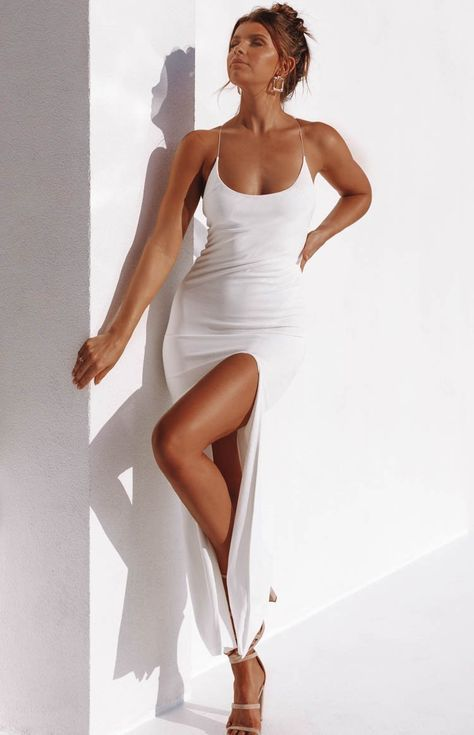 Gracetheir presence with your heavenly appearance in The Alissa Formal Dress in White! A divine mix of a sexy thigh split and a delicate lace-up back, the dress is finished with a flattering curved neckline and a body-hugging fit. Completed in thick soft, stretchy fabric, the dress is fully lined with a trendy raw edge hem. Pull together with glamorous gold accessories, a bold red lip and walk out the door in tonal strappy pumps!    Whiteformal dress  Left leg thigh split  Thin adjus