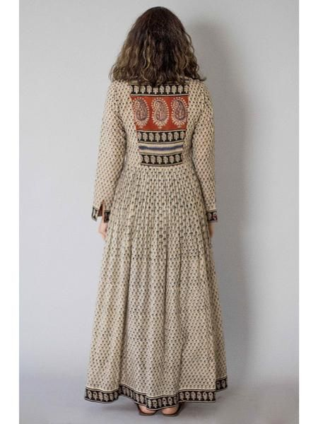 Description: It is a cotton block printed pleated dress with front button down.. Length is 54