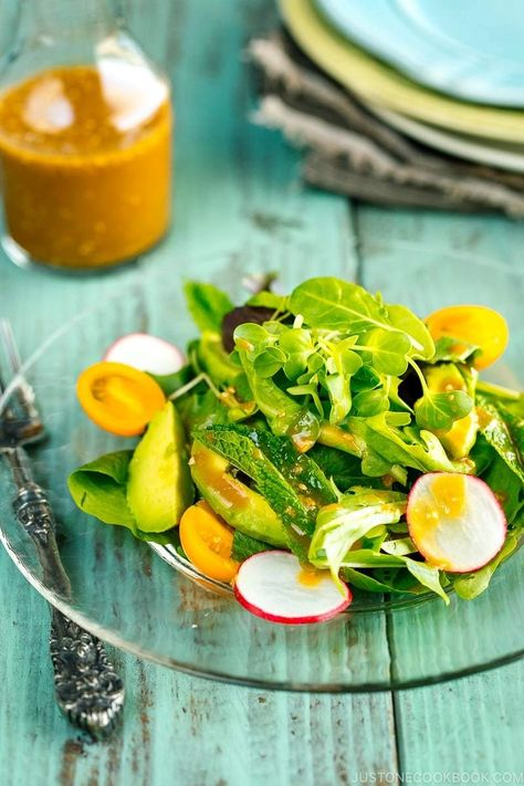 A bright refreshing Spring Mix Salad with Miso Dressing. It has creamy avocado, heirloom tomatoes, sliced radishes and fresh mint leaves in it too. A sure win salad for your grilling menu.#easysalad #saladrecipes #saladwithavocado | Easy Japanese Recipes at JustOneCookbook.com
