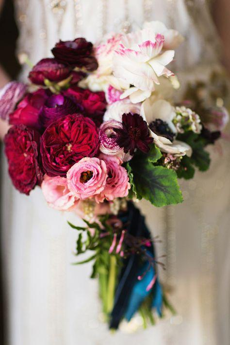 Ombre bridal bouquet of ranunculuses, garden roses, anemones, cosmos, geranium leaves, and jasmine; Lauren & Jon's wedding at Alder Manor // Photo: Jonathan Young