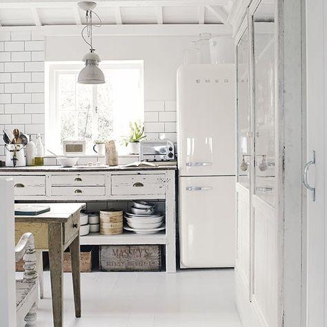 White freestanding kitchen with industrial touches - love the Roberts radio, Smeg fridge/freezer, Dualit toaster, subway tiles, etc