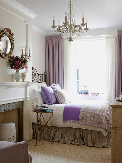 Small rooms can be so cozy with the right bedding, lighting and even a fireplace! I wouldn't want to leave this room!