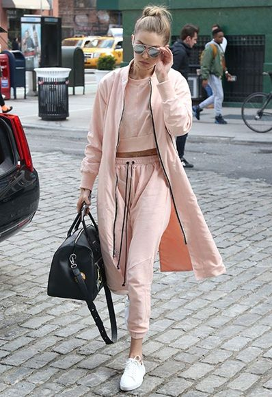 Gigi Hadid wearing a pink tracksuit co-ord and trainers