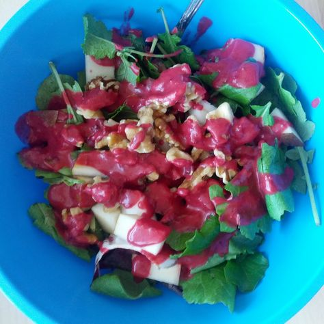Pretty pear salad with vibrant cranberry dressing. Recipe by @Ricki Wells Heller #salad #organic #pear #cranberry