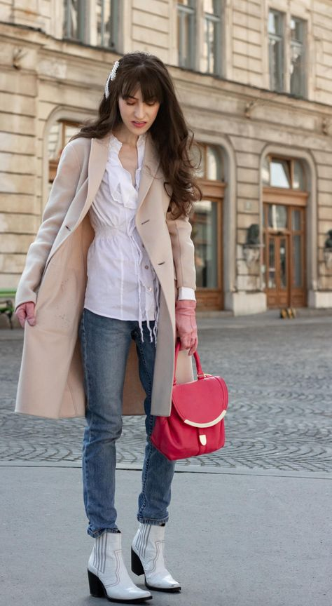 Must follow Slovenian Fashion Blogger Veronika Lipar of Brunette from Wall Street wearing white cowboy Ganni boots Weekend Max Mara coat white fringe shirt a.p.c. washed denim jeans pearl hair accessories See by Chloe pink top handle bag pink gloves on the street