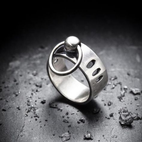 Sterling silver band measuring an even 8mm wide all around with 3 cut outs on each side of the bead and ring. The jump ring through the bead is soldered closed.Please order a 1/2 size up because of the width.HandcraftedOxidized finishSterling silver