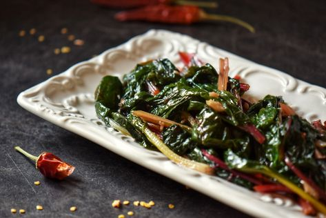 Having a hard time incorporating those healthy, green, leafy vegetablesinto your diet? Once you trythis recipe for Italian-style Sauteed Garlic Swiss Chard, it will no longer be an issue. #swisschard #easysidedish #italiansidedish
