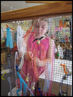 """WEAVING ON A GRAND SCALE! « """"FLIGHTS OF WHIMSY""""  Lots of fine motor skills involved here.  A frame and hardware cloth - should be pretty easy.  Wonder if a parent would be willing to help make it?"""