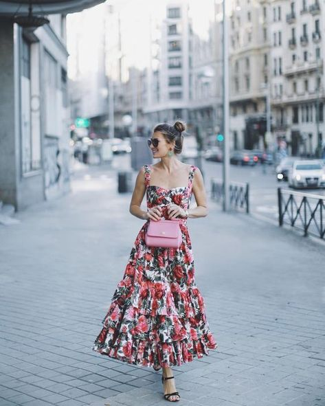 13 a thick strap bright floral maxi dress with a ruffled skirt, a pink bag and black shoes - Styleoholic